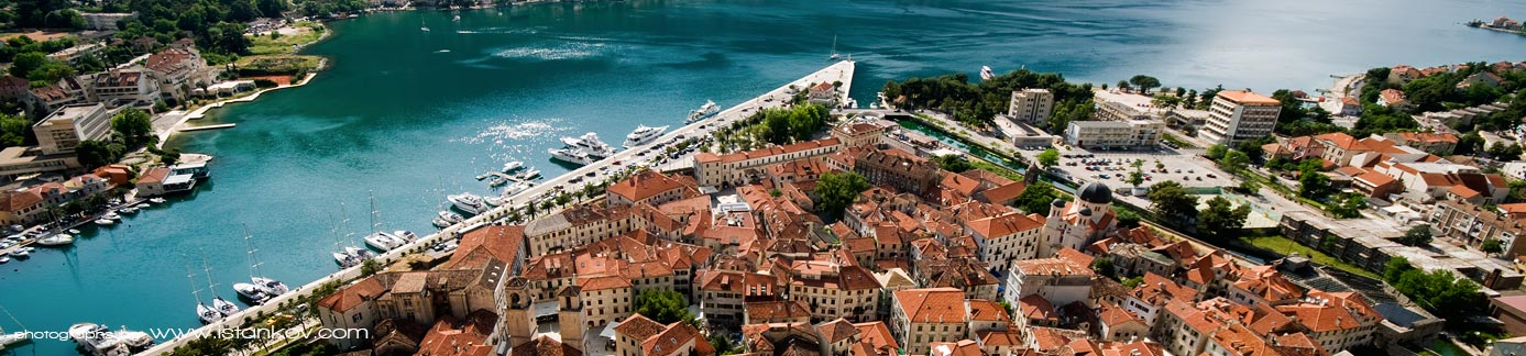 Panorama of Kotor's old town, fortres and pier.